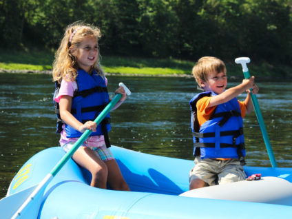 two young kids in blue raft on Delaware River Indian Head Canoeing Rafting Kayaking Tubing Delaware River