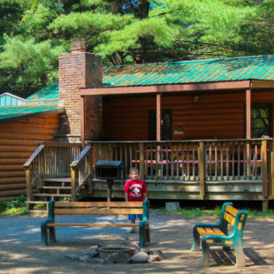 young boy standing outside cabin area Indian Head Canoeing Rafting Kayaking Tubing Delaware River