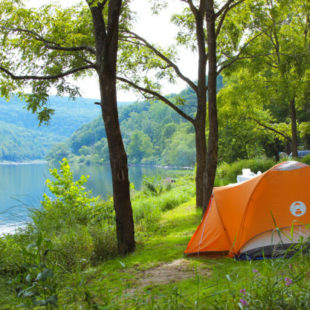 Orange tent set up along the Delaware River Indian Head Canoeing Rafting Kayaking Tubing Delaware River