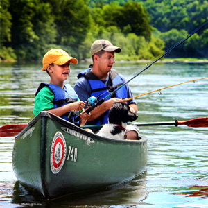 dad and son fishing with their dog in canoe Indian Head Canoeing Rafting Kayaking Tubing Delaware River