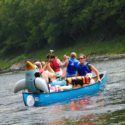 two groups and a dog with life jacket in canoeIndian Head Canoeing Rafting Kayaking Tubing Delaware River