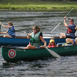 two groups in canoes on river Indian Head Canoeing Rafting Kayaking Tubing Delaware River
