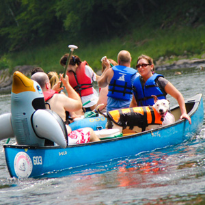 husband wife and dog in blue canoe Indian Head Canoeing Rafting Kayaking Tubing Delaware River