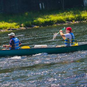 two men paddling canoe Indian Head Canoeing Rafting Kayaking Tubing Delaware River