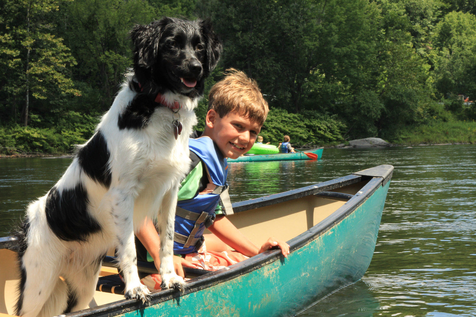 young boy and dog enjoying their canoe ride Indian Head Canoeing Rafting Kayaking Tubing Delaware River