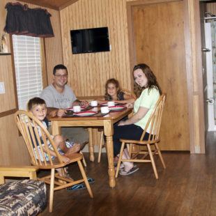 family getting ready for breakfast in deluxe cabin Indian Head Canoeing Rafting Kayaking Tubing Delaware River