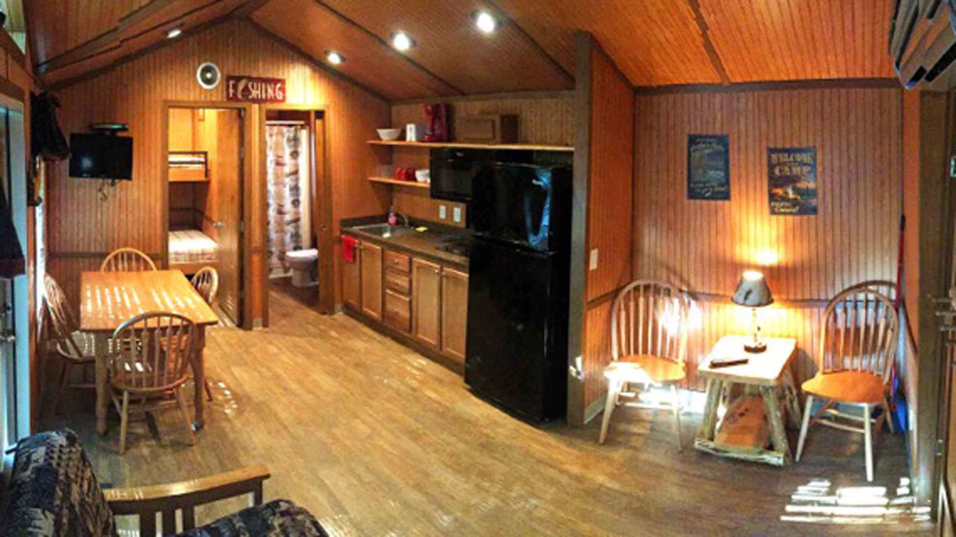 inside amenities included in the deluxe cabin with open floor layout
