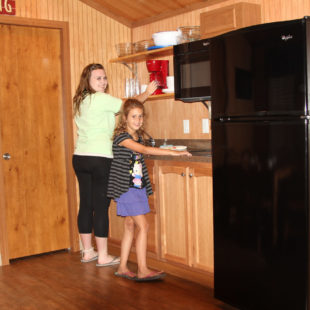 mom and daughter preparing breakfast in cabin Indian Head Canoeing Rafting Kayaking Tubing Delaware River