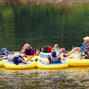 group of 9 enjoying calm waters and scenic views on river Indian Head Canoeing Rafting Kayaking Tubing Delaware River