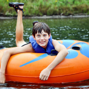 close up of young boy tubing Indian Head Canoeing Rafting Kayaking Tubing Delaware River