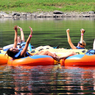 group of 7 enjoying calm waters and scenic views on river Indian Head Canoeing Rafting Kayaking Tubing Delaware River