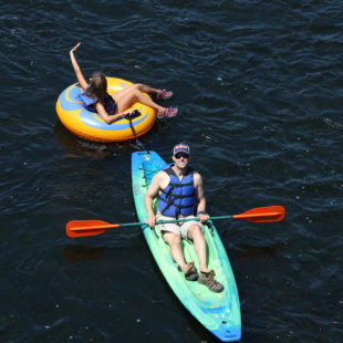 dad in kayak with daughter following in tube Indian Head Canoeing Rafting Kayaking Tubing Delaware River
