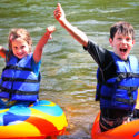 two excited kids in their tubes on the river Indian Head Canoeing Rafting Kayaking Tubing Delaware River