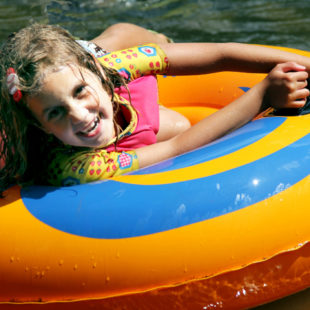 young girl enjoying her tube ride down the river Indian Head Canoeing Rafting Kayaking Tubing Delaware River