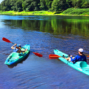 two people in their own blue kayaks in Barryville Indian Head Canoeing Rafting Kayaking Tubing Delaware River