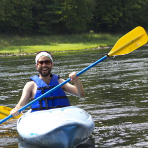 bearded man enjoying kayak ride to Pond Eddy Indian Head Canoeing Rafting Kayaking Tubing Delaware River