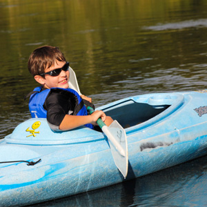 young boy in blue kayak Indian Head Canoeing Rafting Kayaking Tubing Delaware River