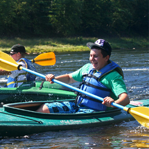 friendly race in kayak Indian Head Canoeing Rafting Kayaking Tubing Delaware River