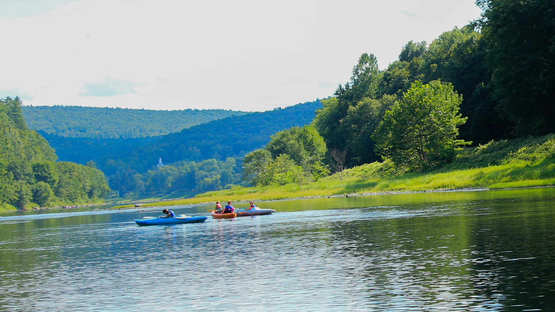 small groups enjoying calm waters and scenic views on river Indian Head Canoeing Rafting Kayaking Tubing Delaware River