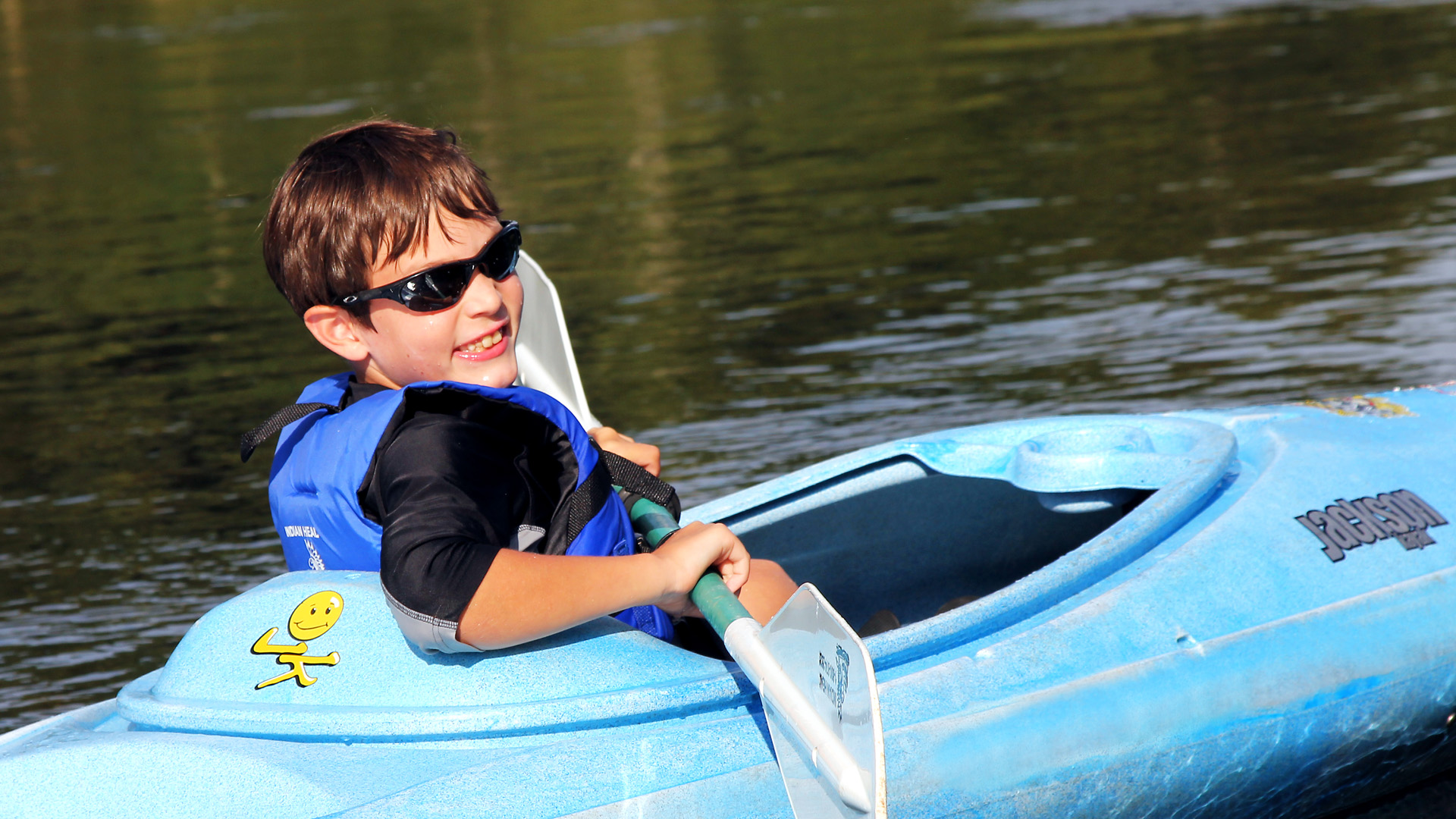 young boy floating in kayak on calm waters Indian Head Canoeing Rafting Kayaking Tubing Delaware River