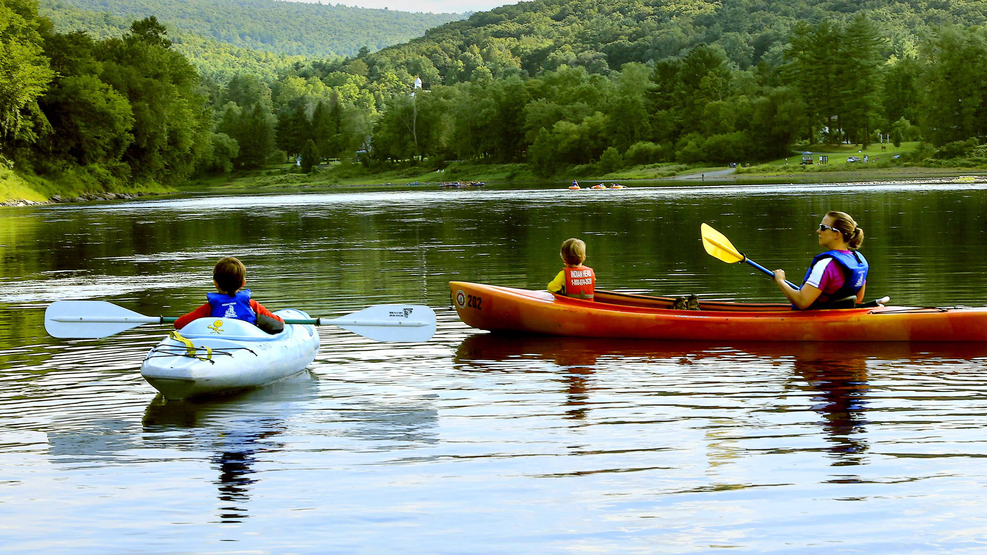 mom and kids enjoying calm waters Indian Head Canoeing Rafting Kayaking Tubing Delaware River