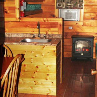 inside view of small fireplace in cabin Indian Head Canoeing Rafting Kayaking Tubing Delaware River