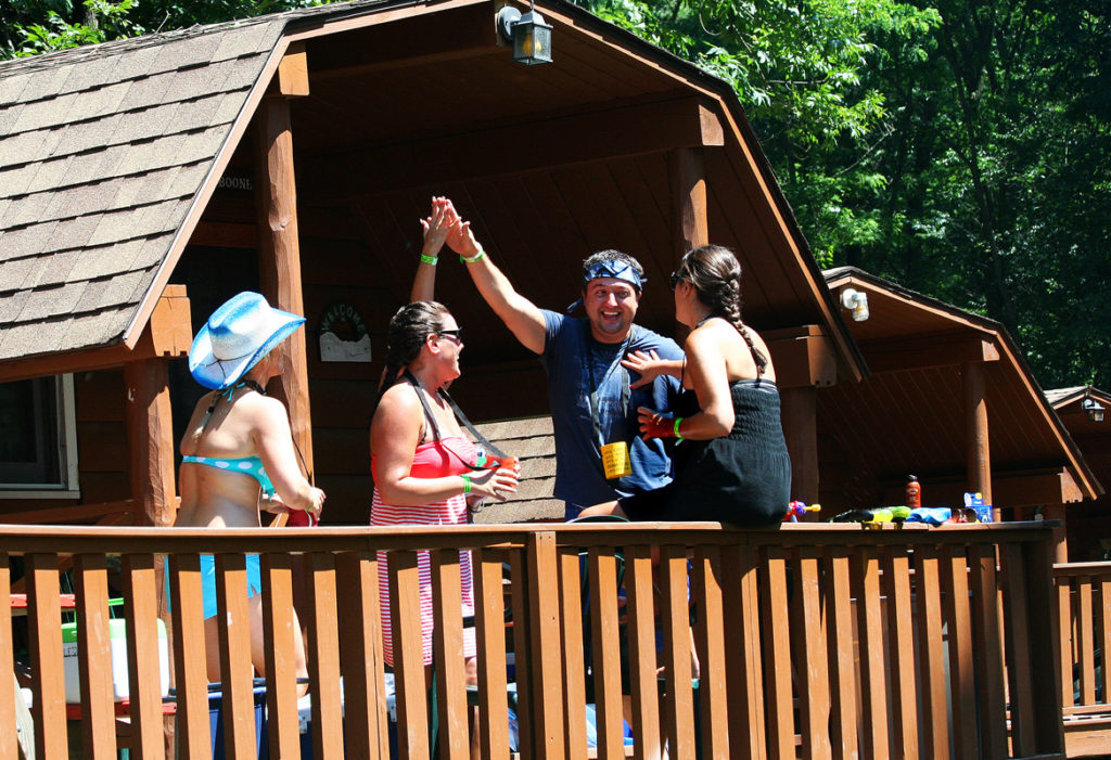 group of friends enjoying the deck in one of our cabins
