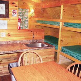 inside cabin with bunk beds and kitchenette Indian Head Canoeing Rafting Kayaking Tubing Delaware River