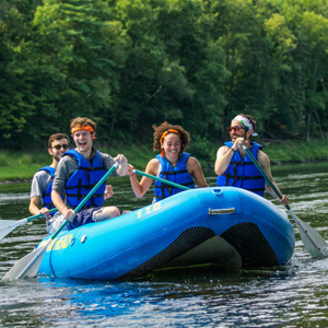 group of four in blue raft in Barryville Indian Head Canoeing Rafting Kayaking Tubing Delaware River