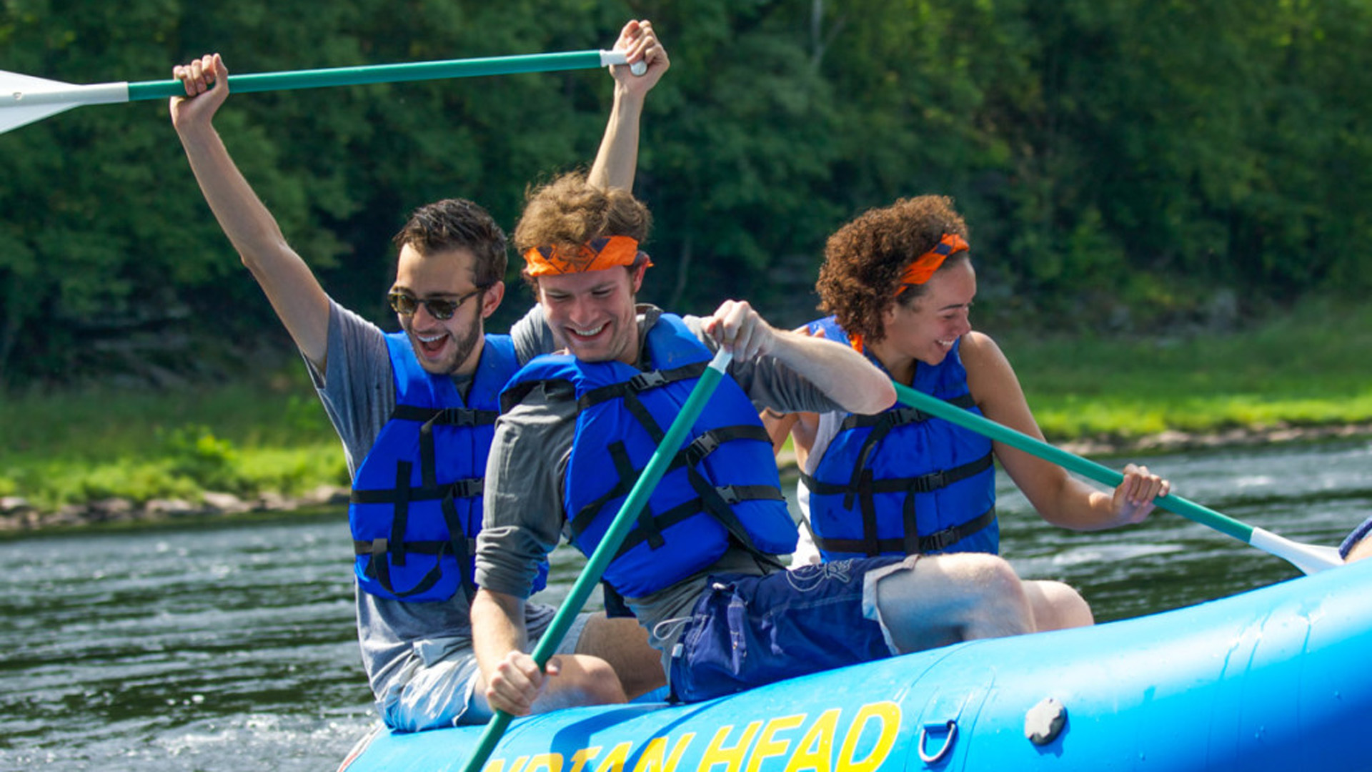 friends smiling while rafting on Delaware River Indian Head Canoeing Rafting Kayaking Tubing Delaware River