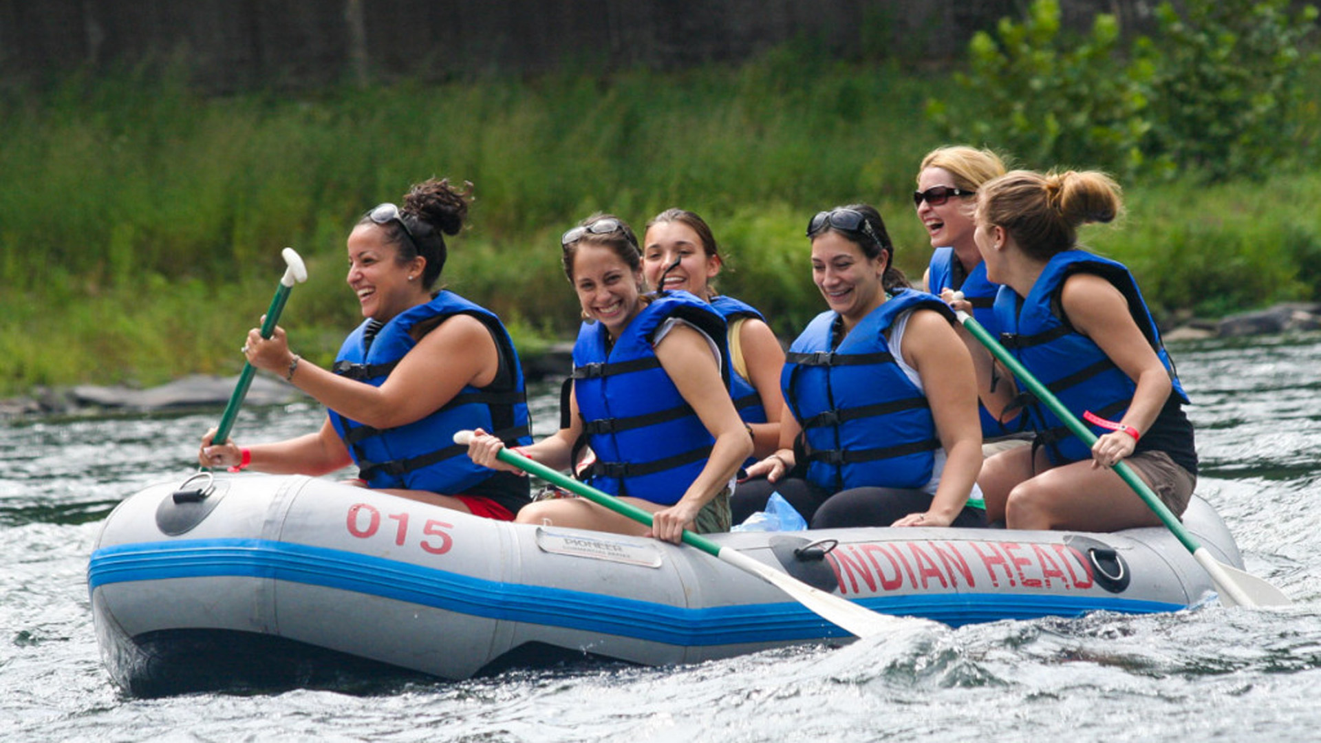 girlfriends enjoy a laugh on whitewater Indian Head Canoeing Rafting Kayaking Tubing Delaware River