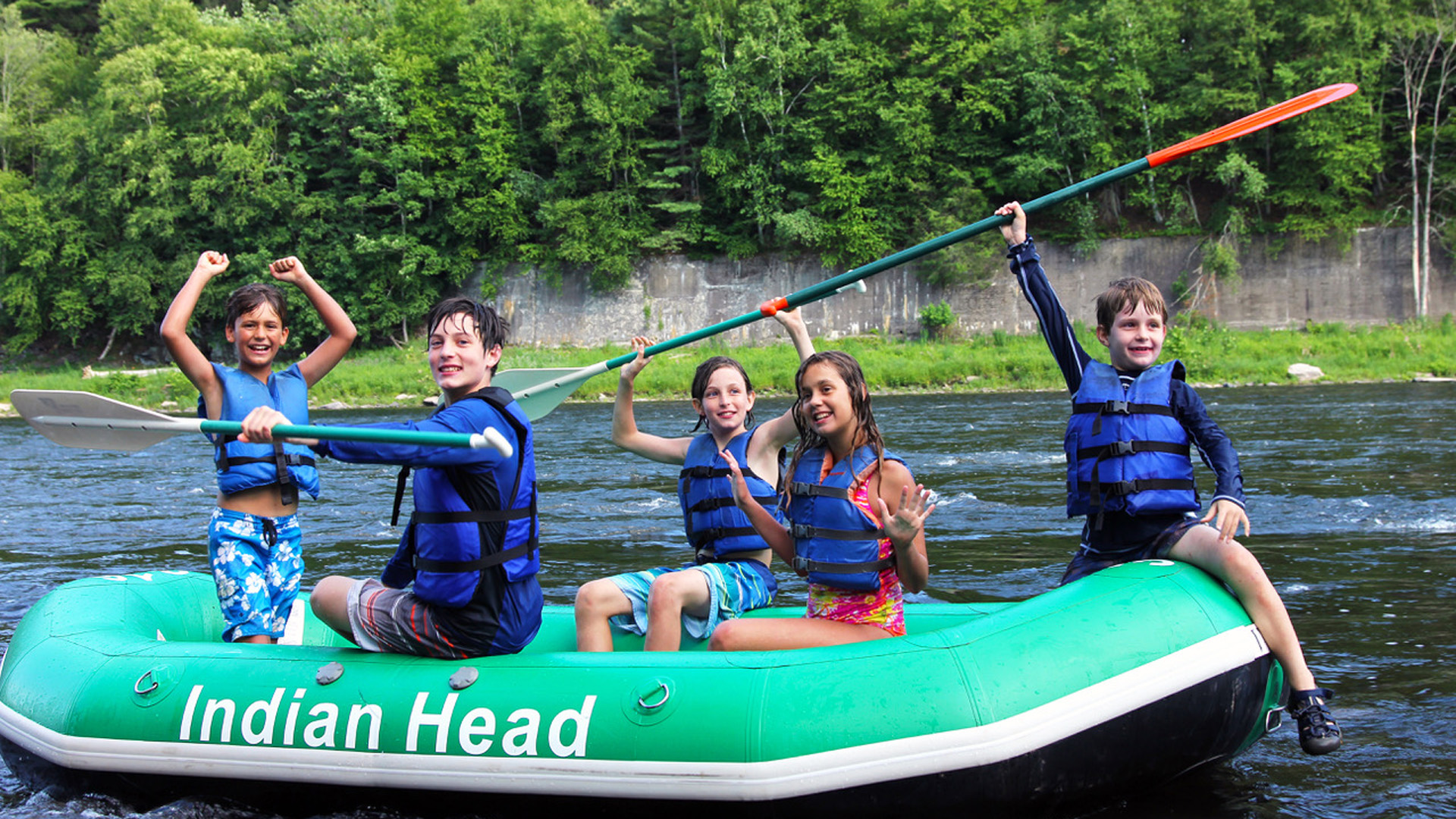 kids in raft celebrate after arriving to shore Indian Head Canoeing Rafting Kayaking Tubing Delaware River