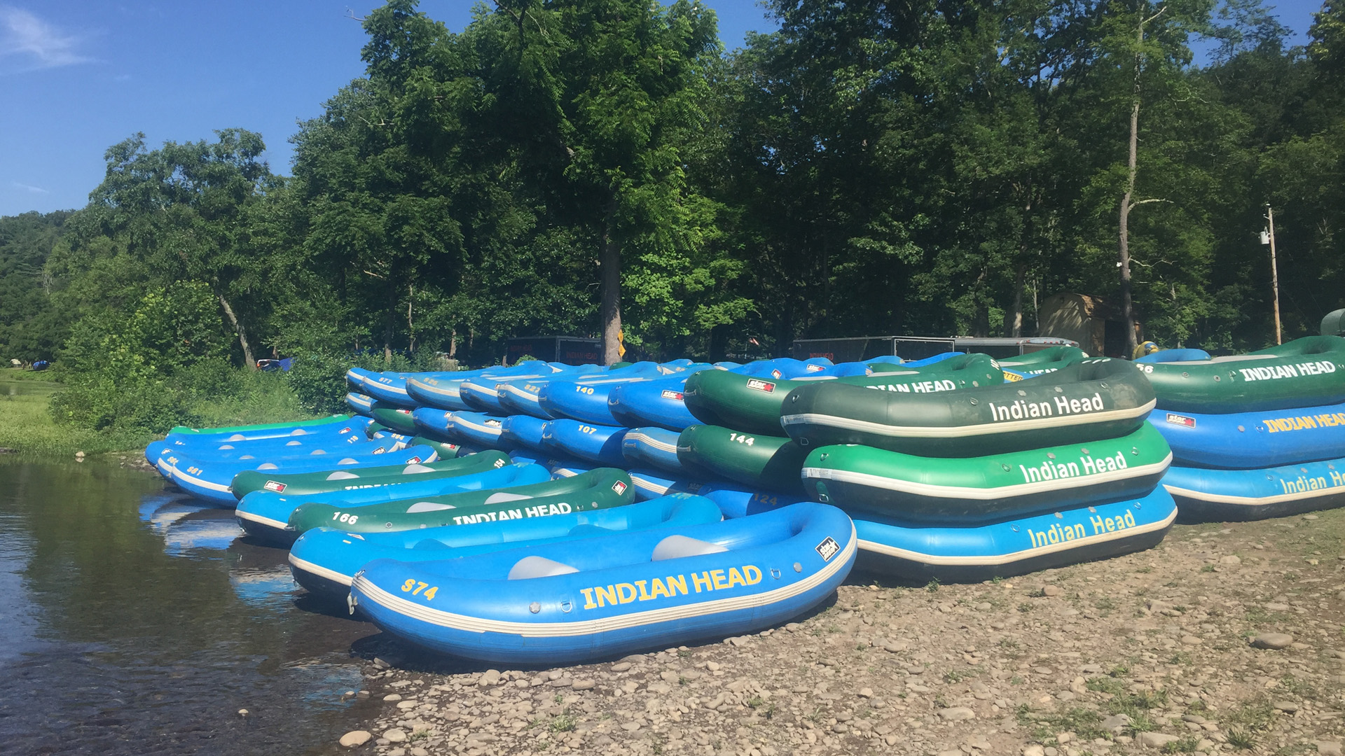 rafts staged on shore ready for guests Indian Head Canoeing Rafting Kayaking Tubing Delaware River