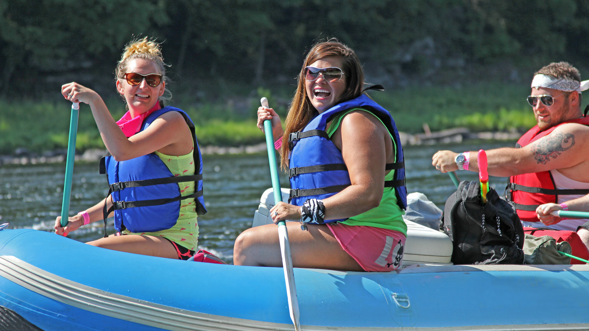 friends in raft enjoying a sunny day Indian Head Canoeing Rafting Kayaking Tubing Delaware River