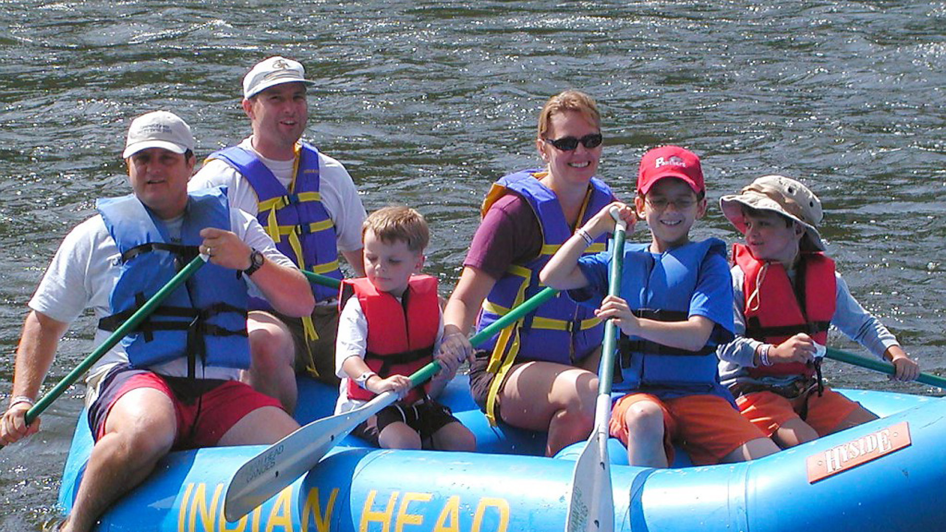 family of 6 navigating the Delaware River in a raft Indian Head Canoeing Rafting Kayaking Tubing Delaware River