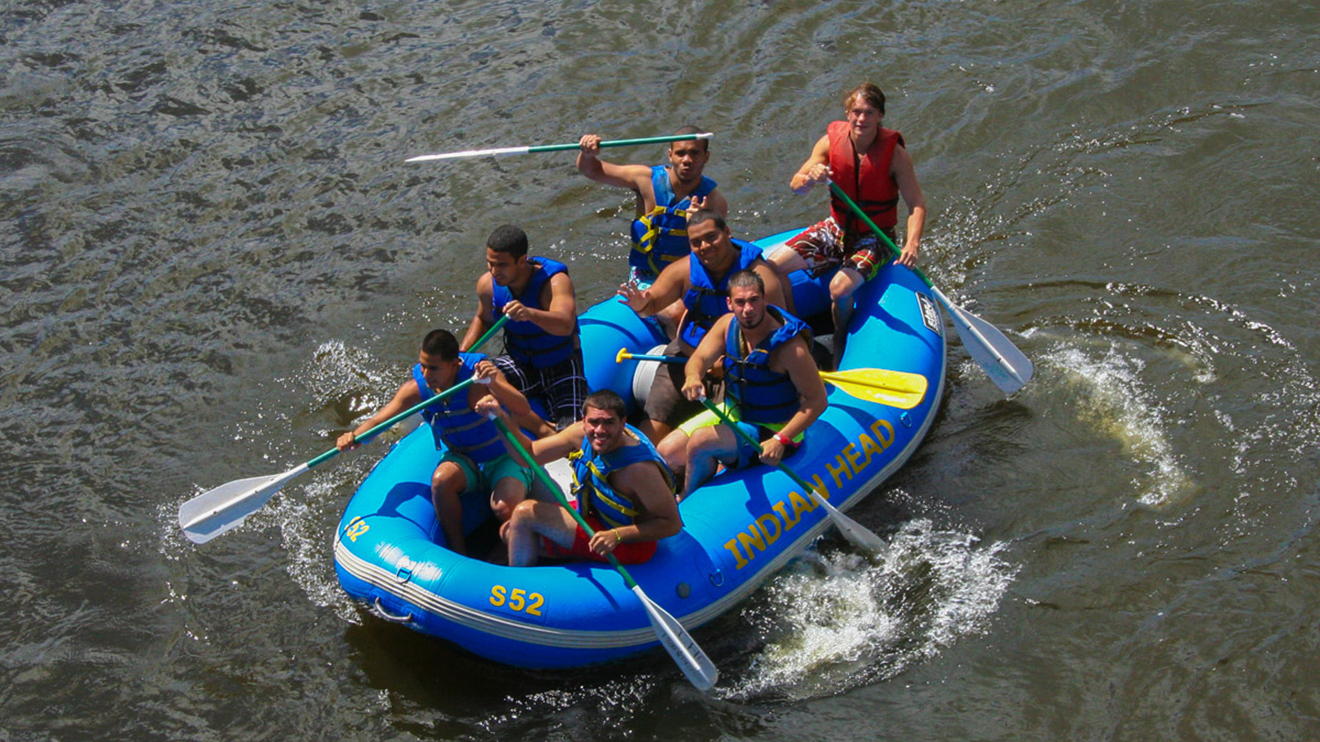 guy friends look up from raft to smile at camera Indian Head Canoeing Rafting Kayaking Tubing Delaware River