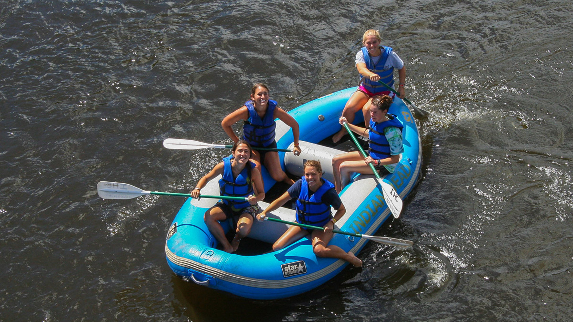girlfriends in raft looking up at camera Indian Head Canoeing Rafting Kayaking Tubing Delaware River