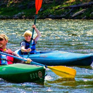 father and son in separate kayaks Indian Head Canoeing Rafting Kayaking Tubing Delaware River