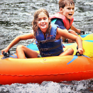 two kids enjoying tubing on Delaware Indian Head Canoeing Rafting Kayaking Tubing Delaware River