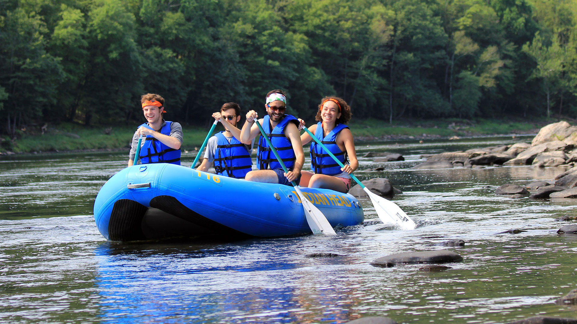group of four in raft Indian Head Canoeing Rafting Kayaking Tubing Delaware River