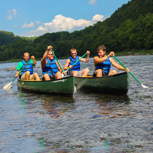 Two groups of males in canoes Indian Head Canoeing Rafting Kayaking Tubing Delaware River